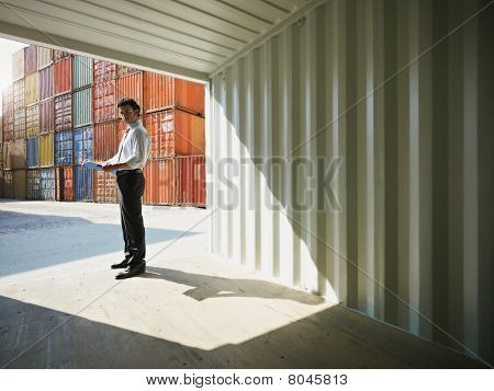 Business Man With Shipping Containers