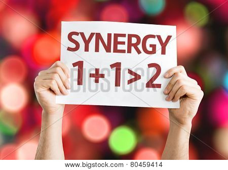 Synergy 1+1>2 card with colorful background with defocused lights