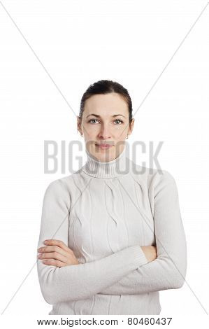 Portrait Of A Woman Wearing White Sweater Posing With Arms Across Isolated Over White
