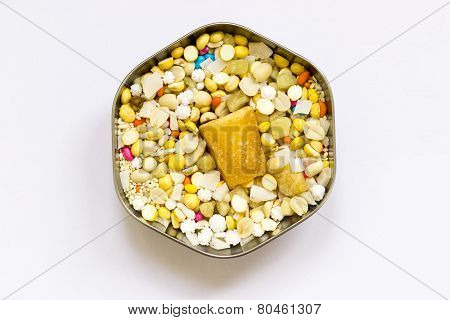 A hexagonal cup filled with dry nuts and sweets as per Indian traditional offerings to Hindu temple