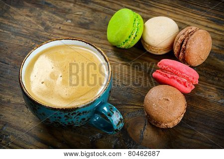 Delicious French macarons almond cookies served with a cup of black coffee