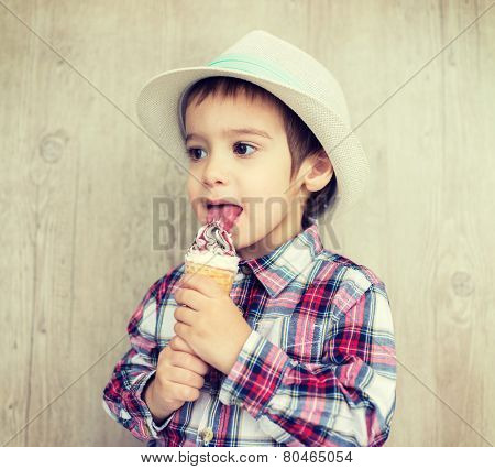 Portrait of baby child with sweet ice cream