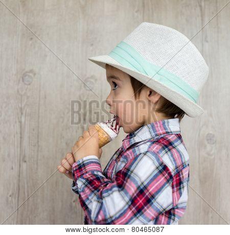 Portrait of baby child with sweet ice cream