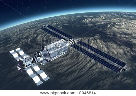 Telecommunication Satellite flying over Earth