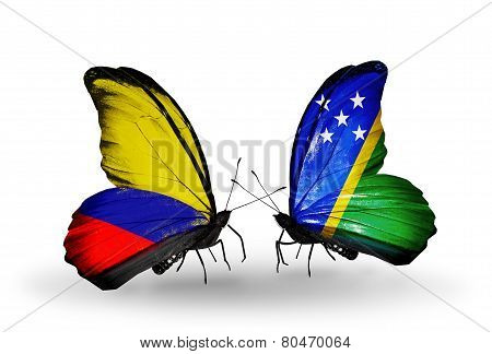 Two Butterflies With Flags On Wings As Symbol Of Relations Columbia And Solomon Islands