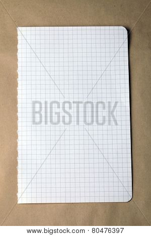 Checked Note On Craft Paper Background