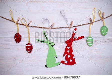 Easter Bunny Couple And Easter Eggs Hanging On Line With Frame
