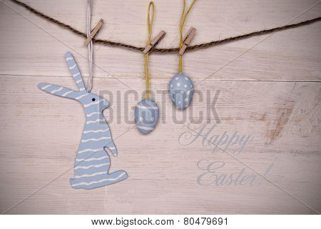 Blue Easter Bunny And Easter Eggs Hanging On Line With Happy Easter