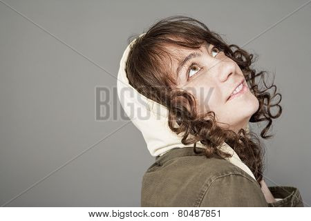 Cute And Funny Young Caucasian Girl With Long Curly Hair Over Gray Background