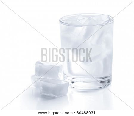 Glass with ice cubes isolated on white