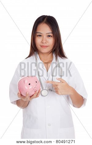 Young Asian Female Doctor Point To A Pig Bank Coin
