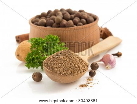 allspice in spoon isolated on white background