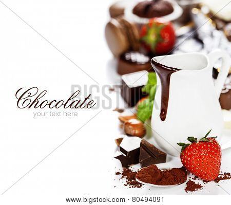 Delicious rich and thick chocolate sauce in a jug and assorted chocolates - food and drink