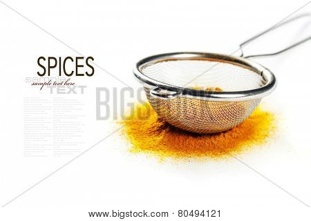 Yellow curry powder in strainer (with easy removable sample text)