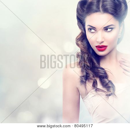 Beauty fashion model retro girl over blinking background. Vintage style Woman Portrait. Luxury Lady with Holiday Magic background. Miracle Light. Copy Space