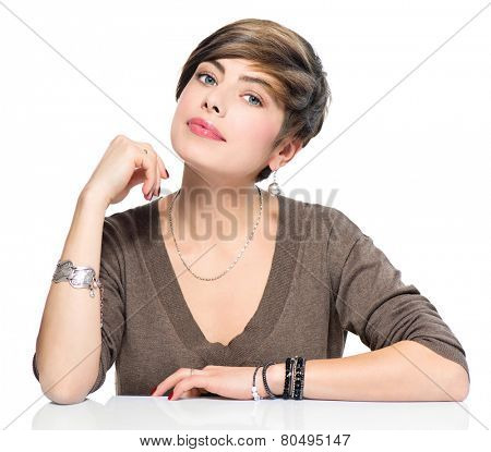 Young beauty woman with short bob hairstyle, beautiful make up, fresh skin, wearing accessories, isolated over white background. Portrait of attractive modern girl with brown short hair.