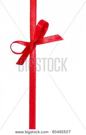 Festive red gift ribbon and bow isolated on white