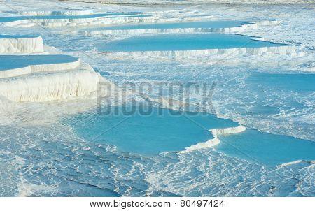 Blue pools and white travertine terraces at Pamukkale, Turkey