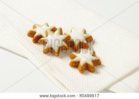four christmas star cookies on white napkin