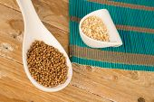 stock photo of citronella  - Dried coriander seeds and chopped lemon grass - JPG