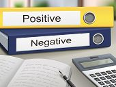foto of positive negative  - positive and negative binders isolated on the office table - JPG