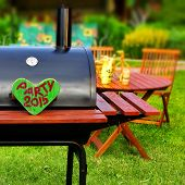 picture of souse  - BBQ Party Sign on Wooden Heart at Barbecue Appliance on the Backyard at Summertime - JPG