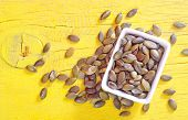 stock photo of fibrin  - pumpkin seed in bowl and on a table - JPG