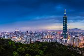 foto of illuminating  - Blue hour night sky and illuminated city lighting of wide cityscape of Taipei - JPG