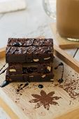 picture of brownie  - Delicious Chocolate Brownies on Wooden Plate with flappe - JPG