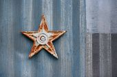 picture of red siding  - Metal star on barn siding red white and blu - JPG