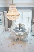 stock photo of chandelier  - Crystal chandelier and circular table in dinning room - JPG