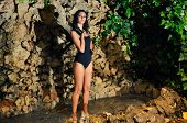 stock photo of cave woman  - Portrait of a beautiful young woman model of fashion in a garden stairs - JPG