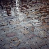 stock photo of paving stone  - Wet paving stone with puddles  - JPG
