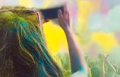 stock photo of eastern culture  - Young woman taking photo on mobile phone on holi color festival - JPG