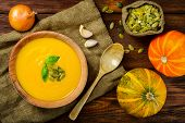 stock photo of butternut  - Homemade Autumn Butternut Squash Soup rustic brown wooden table - JPG