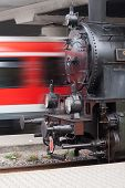 stock photo of passenger train  - Steam locomotive and passenger train, symbolic for fast or slow ** Note: Soft Focus at 100%, best at smaller sizes - JPG