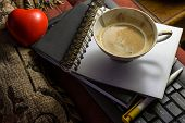 foto of office romance  - Red heart and coffee cup with office supplies objects - JPG