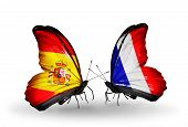 picture of spanish money  - Two butterflies with flags on wings as symbol of relations Spain and France - JPG