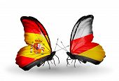 picture of spanish money  - Two butterflies with flags on wings as symbol of relations Spain and South Ossetia - JPG