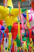 stock photo of pinata  - Holiday pinatas being sold in a pubic market in Mazatlan - JPG