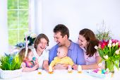stock photo of baby easter  - Happy young family with three children  - JPG
