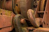 stock photo of crane hook  - One larger old crane hook rusted and a bit of moss on it to - JPG