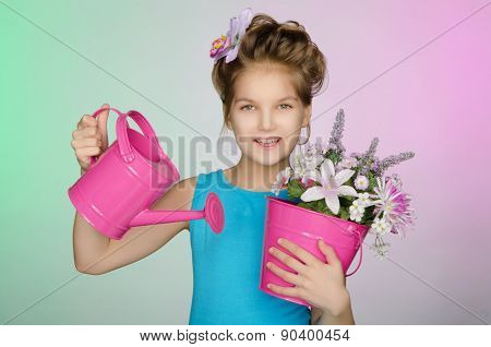 Happy Girl With Watering Can And Flowers
