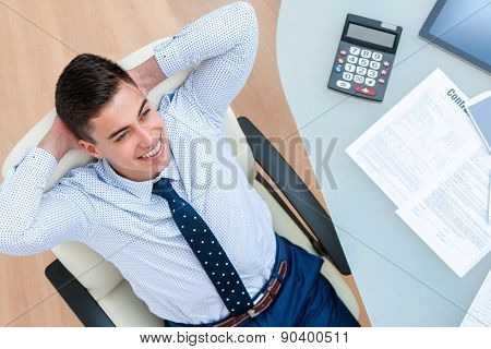 Office Worker Taking A Brake At Desk.