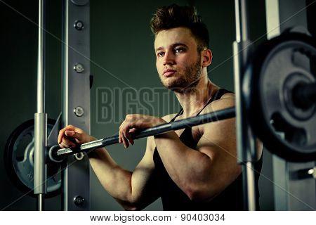 Strong Bodybuilder Athlete Portrait  With Heavy  Weights In Gym
