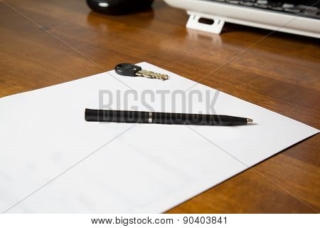 Blank Paper On The Desk With Pen And Key