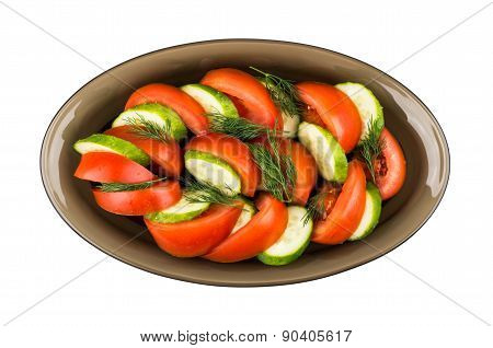 Salad Of Tomatoes And Cucumbers With Dill In Glass Dish