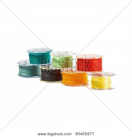 Plastic spools of threads.