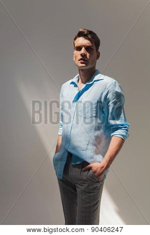 Picture of a handsome casual man standing with his hand in pockets