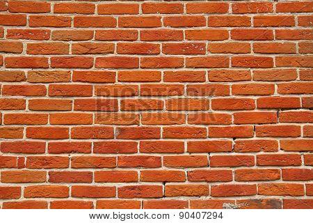 Wall Of Orange Annealed Bricks